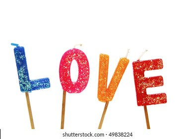 birthday cake candles forming the word love isolated on a white background