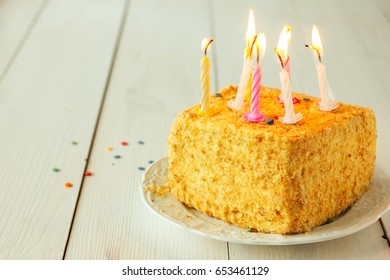 Birthday cake with candles on wooden table selective focus