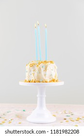 Birthday cake with candles. Birthday party celebration concept. Vertical, grey background
