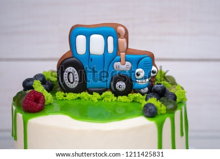 Birthday Cake For A Child With Toy Tractor And Fresh Berries