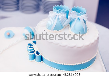 Birthday Cake With Children Shoes On Top