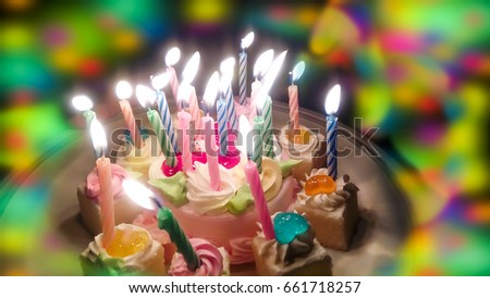Birthday Cake And Colorful Blur Light In Party