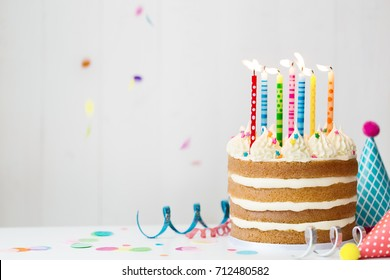 Birthday cake with colorful candles at a birthday party