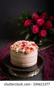 Birthday cake with cream. Beautiful cream roses. The Malaysian technique