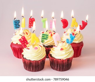Birthday cake cupcake with cute candle light lit up for children's birth day anniversary celebration, greeting card and party invitation
