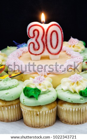 Birthday Cake And Cupcakes In Pastel Colors With A Number Thirty 30 Burning Candle Buttercream