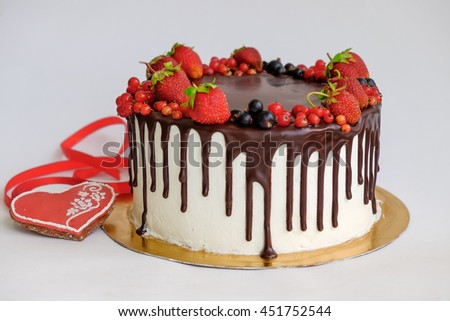 Birthday Cake Decorated By Chocolate And Berry Strawberry On Top Near Red Gingerbread Like Heart