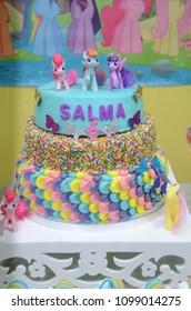 A birthday cake decorated with characters. My Little Pony
