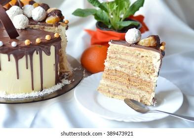 Birthday cake decorated with chocolate and mandarin