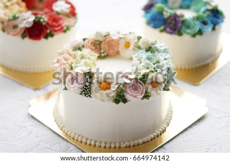 Birthday Cake With Flowers On Lace White Background