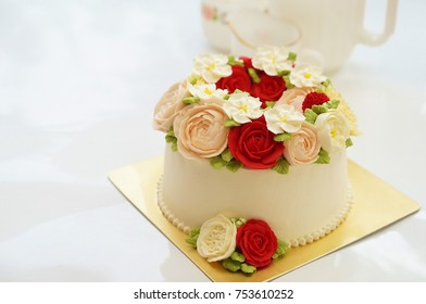 Birthday Cake With Flowers On White Background