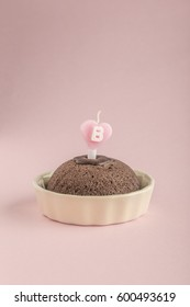 birthday cake with heart shaped candle letter b on it