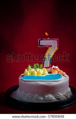 Birthday Cake Lit Candle For A Seventh Or Anniversary Celebration
