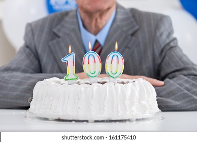 Birthday Cake With Lit Candles For A Century One Hundredth