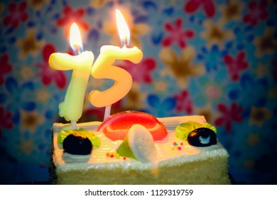 Birthday Cake A Number 75 Seventy Five Candle Is Burning In The Middle Of