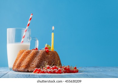 Birthday cake with  one candle on color background