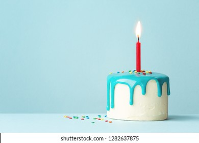 Birthday cake with one red candle and drip frosting