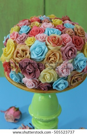 A Birthday Cake With Roses Made Of Fondant And Modeling Chocolate On Green Stand