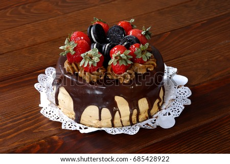 Birthday Cake With Strawberries And Chocolate On Dark Wood Table