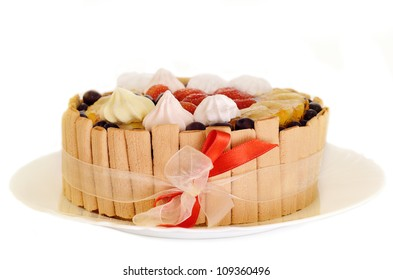 Birthday cake with strawberry, banana and red ribbon