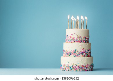 Birthday cake with three tiers and colorful sprinkles - Shutterstock ID 1391096552