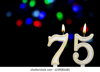 Birthday Candles On Black Background With Defocused Colorful Garland Number 75