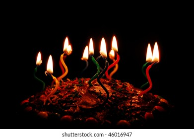 Birthday candles on cake with black background