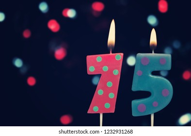 Birthday Candles On Dark Background With Defocused Colorful Garland Number 75