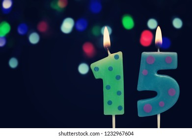 Birthday Candles On Dark Background With Defocused Colofrul Lights Number 15