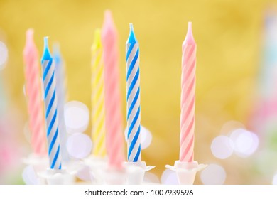 birthday candles on yellow background