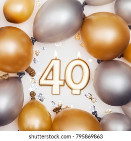 Birthday celebration number 40 candle with gold and silver balloons