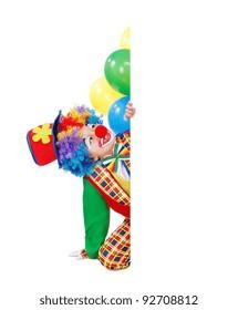 Birthday clown sitting on the floor behind the blank board