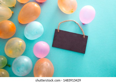 Birthday concept with baloons. Overhead flatlay baloons with greeting