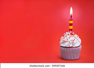 Birthday cupcake decorated with a stripey candle