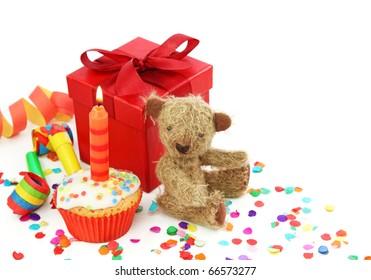 Birthday cupcake with gift box and teddy bear