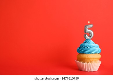 Birthday cupcake with number five candle on red background, space for text