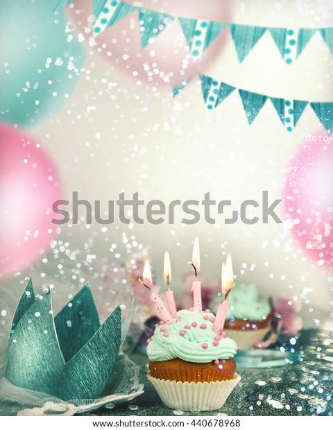 Birthday cupcake on table on light festive background
