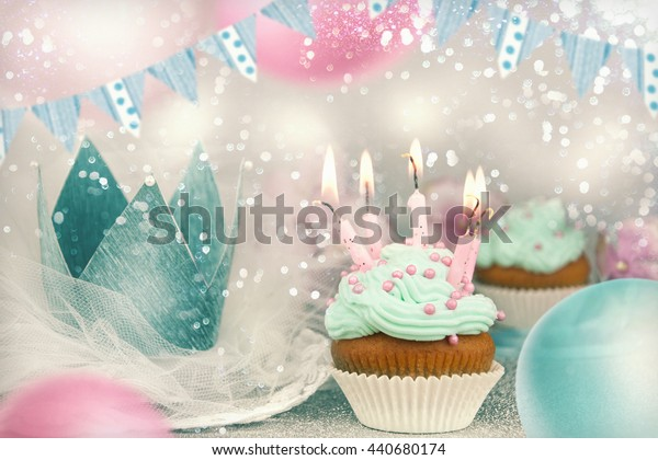 Birthday cupcake on table on light festive background