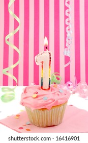 birthday cupcake with pink frosting and and decorative background celebrating baby's first anniversary