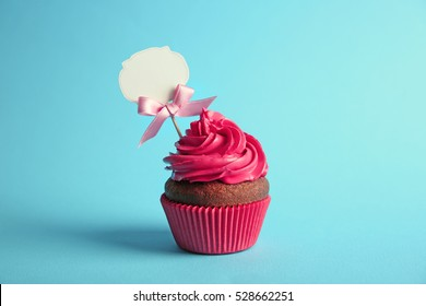 Birthday cupcake with space for text on blue background