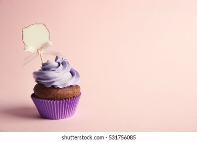 Birthday cupcake with space for text on lilac background