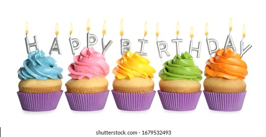 Birthday cupcakes with candles on white background