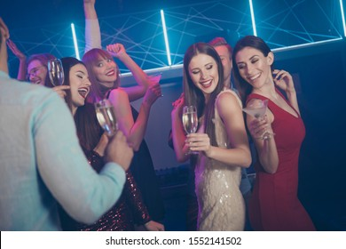 Birthday day occasion holiday event loud sound concept. Photo of excited crazy carefree in short mini dress formal wear ladies guys enjoying wine glass beverage dancing on dj music