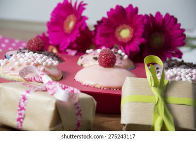 birthday decoration with flowert, presents and muffins