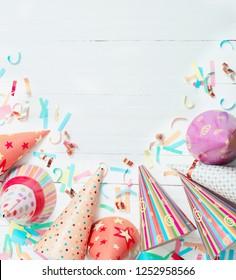 birthday decoration on white wooden background