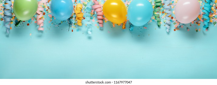 Birthday decoration,balloon and streamers on blue background