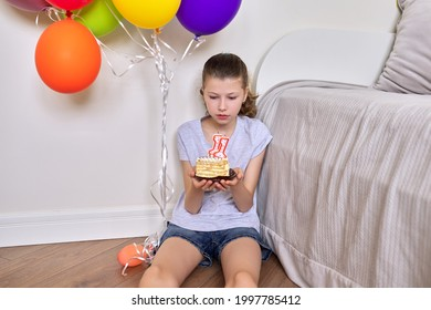 Birthday eleven years old, preteen girl with a small cake and candles 11