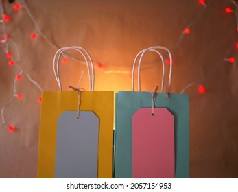 Birthday gift bags with labels on colorful background medium shot