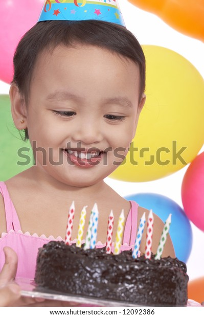 birthday girl holding a delicious chocolate cake