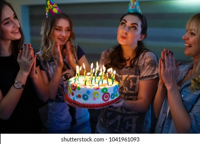Birthday. Girls with a cake with candles.